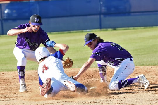 Wylie second baseman Tyler Martin (31) puts the tag on Cooper's Brody Stanford (4) at Cougar Field on Tuesday, April 9, 2019. Wylie pulled out the 11-5 win.