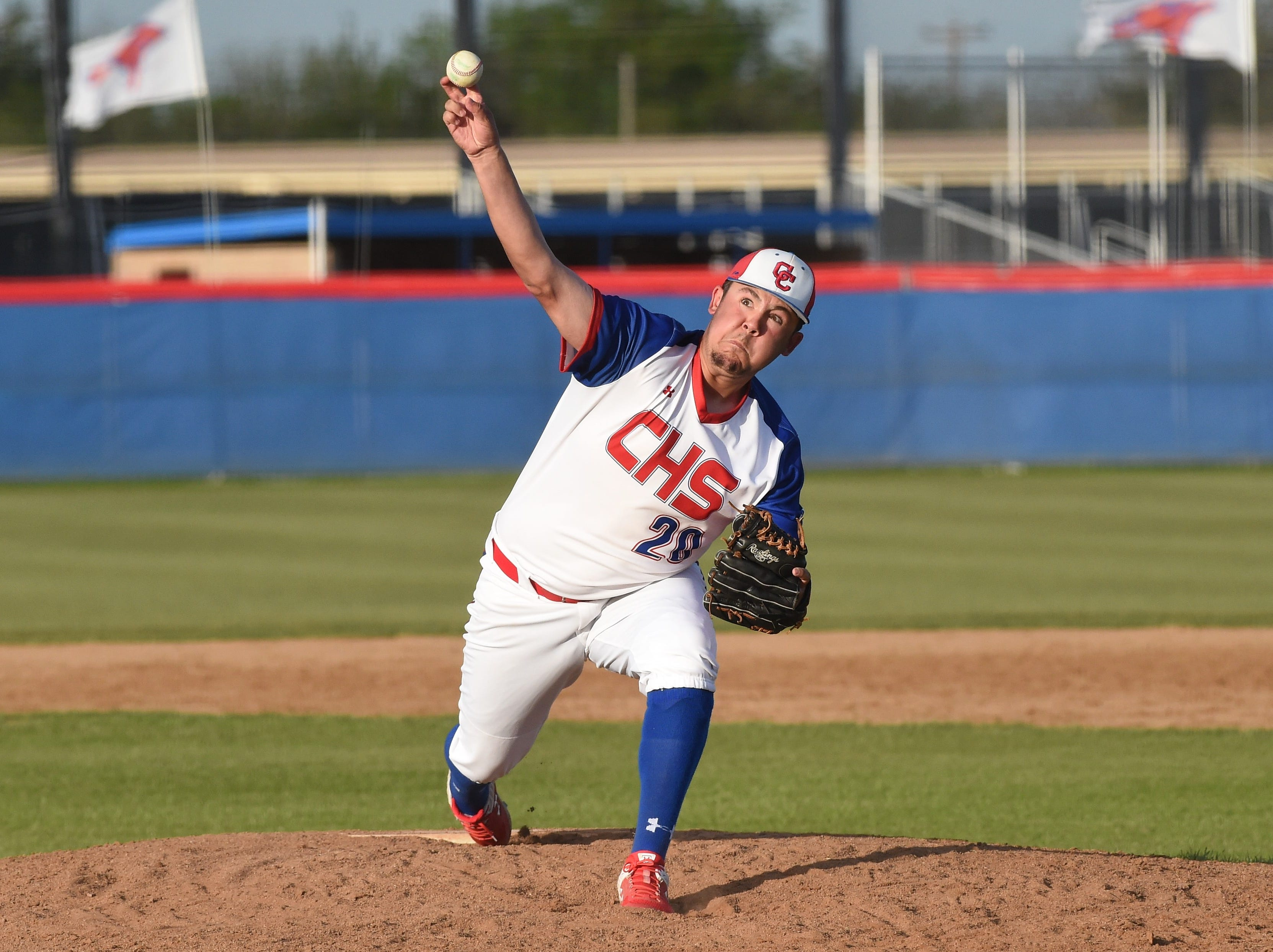 Cooper reliever Andrew Gomez (20) lets go of a pitch against Wylie at Cougar Field on Tuesday, April 9, 2019. Gomez worked 1.1 no-hit, shutout innings in the 11-5 loss.