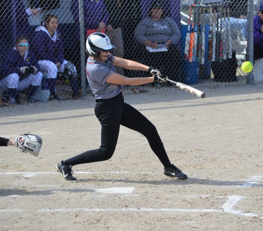 Marshall's Alayna Dornton takes a swing during an early-season game against Lakeview.