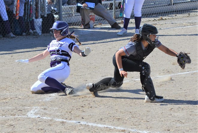 Lakeview's Annalisse Palma slides home safe as Marshall catcher Izzy Franks takes the throw.