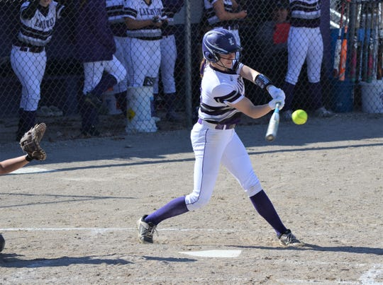 Lakeview's Annalisse Palma keeps her eye on the ball as she takes a swing during a game against Marshall.