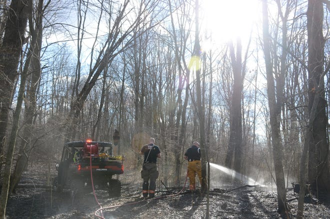 Firefighters worked for more than two hours fighting a brush fire in Emmett Township Tuesday evening.