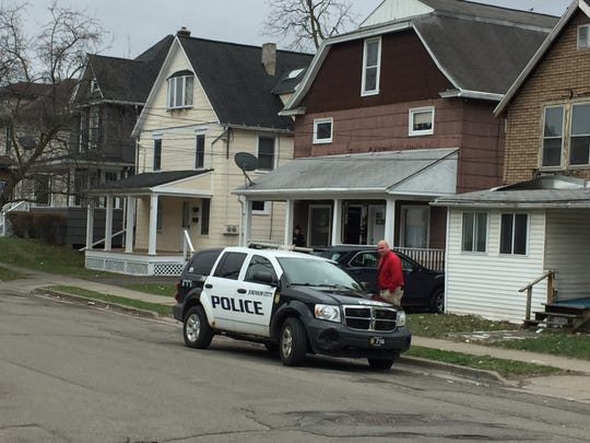 Johnson City police investigate a residence on Harrison Street on Wednesday, April 10, 2019. The previous night, officers responded to a shots fired incident not far away on Grand Avenue.