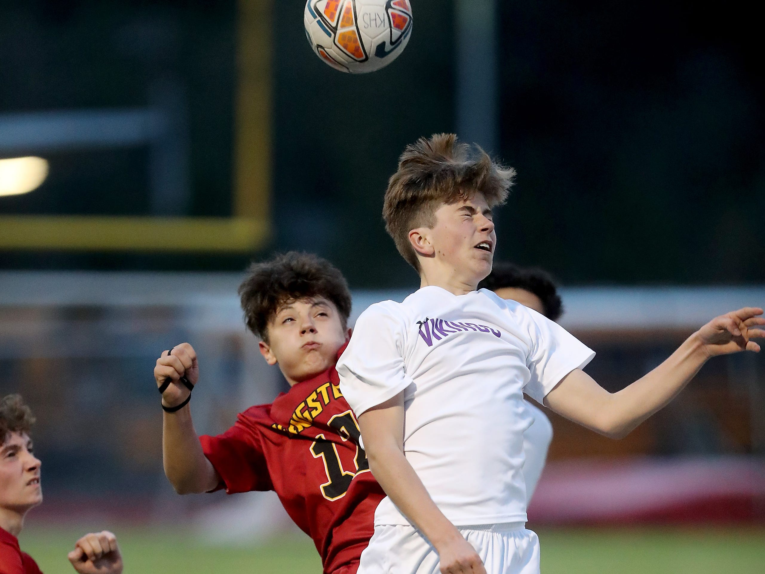 North Kitsap's Aurthur Stalin (front) and Kingston's Kaden Schaefer Soccer go up for a header during ther game in Kingston on Tuesday, April 9, 2019.