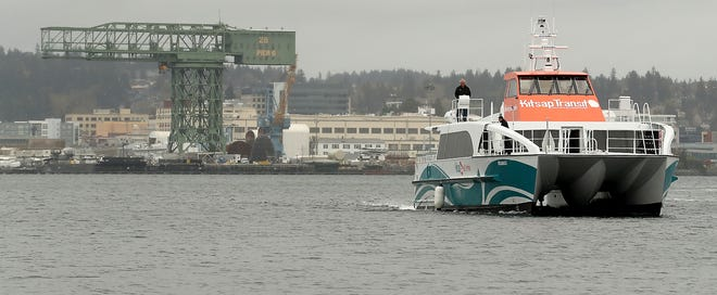 Captain Tim Cain pilots Kitsap Transit's new fast ferry, the Reliance, from the Bremerton dock to Port Orchard on Wednesday.