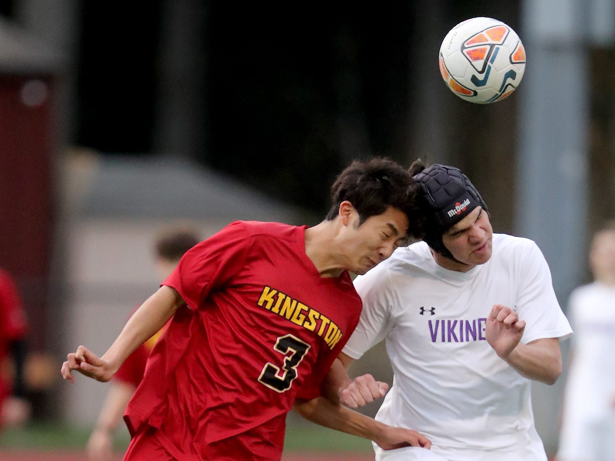 Kingston's Ryuzo Kumei (3) and North Kitsap's Luca Laura connect wth a header in Kingston on Tuesday, April 9, 2019.