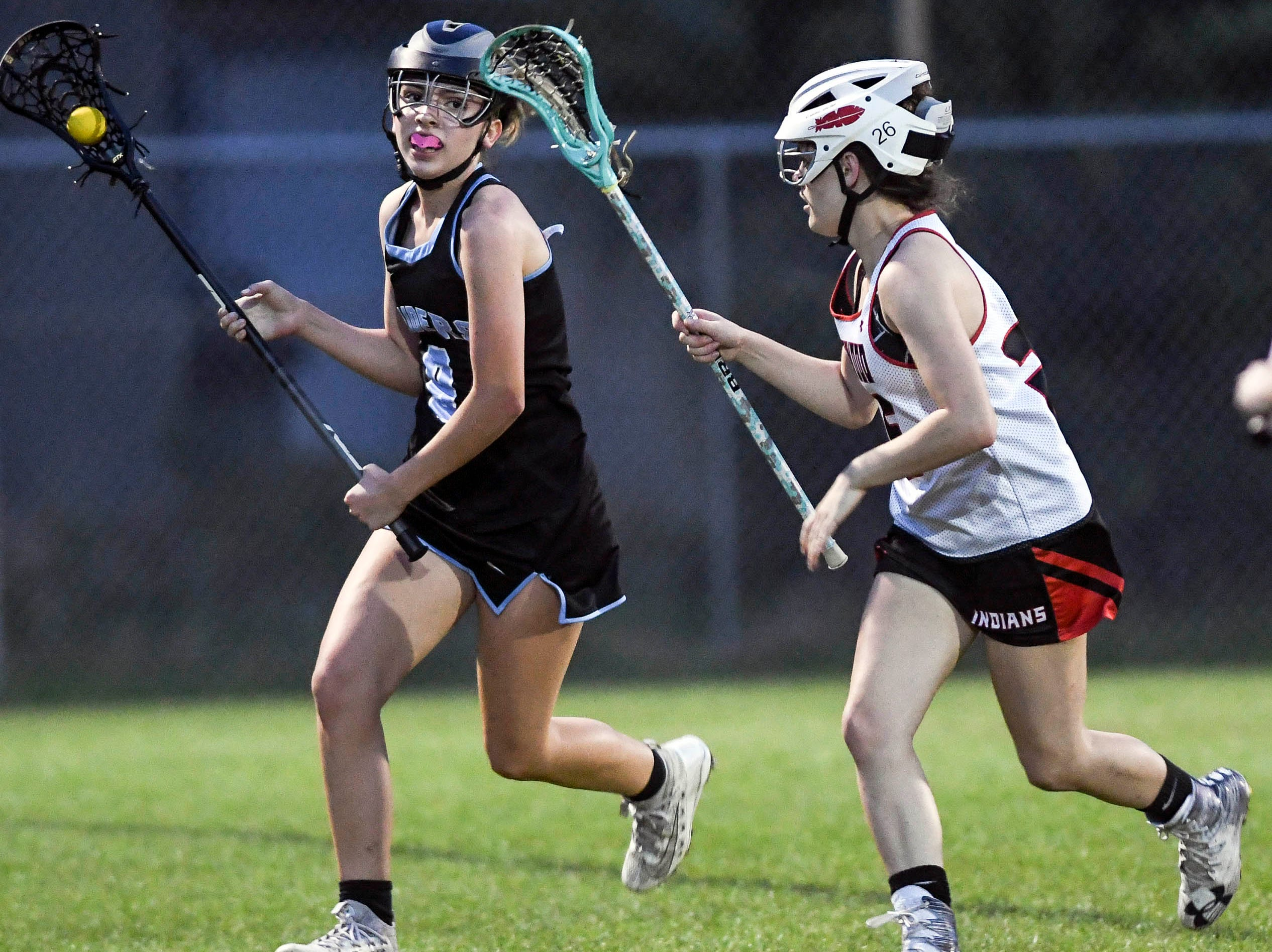 Rockledge's Sofia Baldwin is pursued by Jessica Ruiz of Edgewood during Tuesday's game.