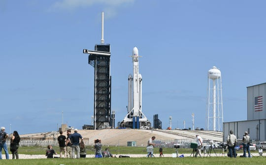 SpaceX's Falcon Heavy rocket stands ready at Kennedy Space Center's pad 39A ahead of the Arabsat 6A mission on Wednesday, April 10, 2019.