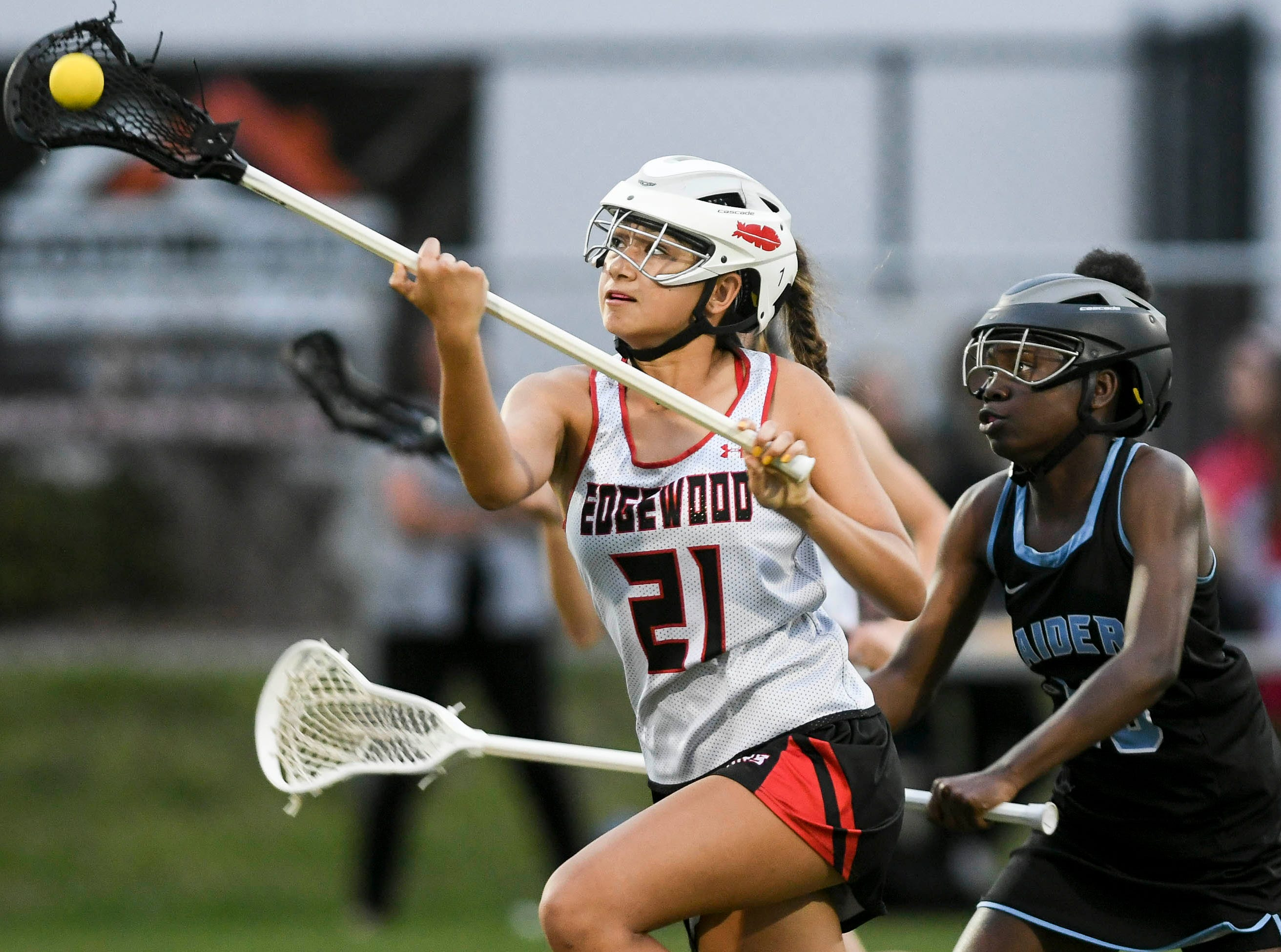 Edgewood's Jasmine Almeda controls the ball n front of Rockledge's Raven Kearse Tuesday's game.