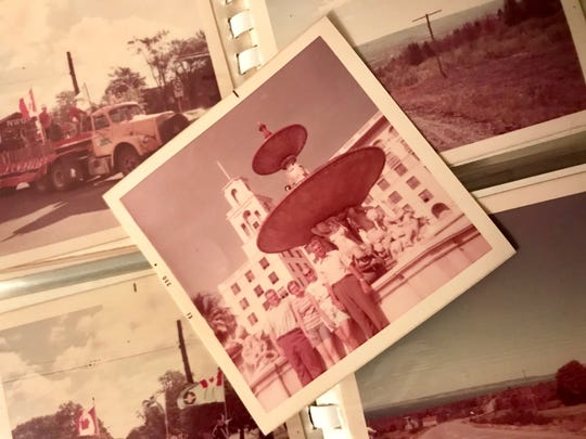 Insurance agency owner Barry Ranew found a photo album in his parking lot in 2011, and since then, FLORIDA TODAY reporter Britt Kennerly has wanted to return the photos to someone in the family pictured in  the book.