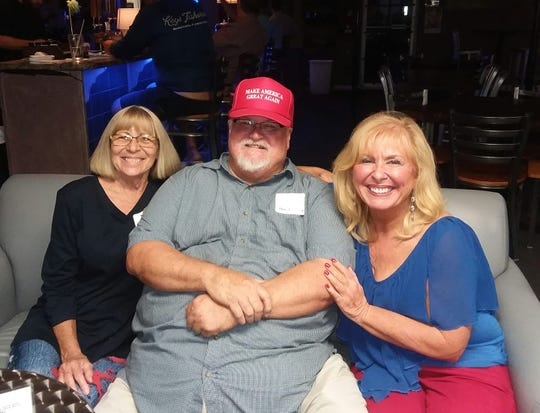 "Robert Chapman, seen here wearing a ""Make America Great Again"" hat, sits in between Vicki Ulrich Impoco of the Space Coast Progressive Alliance and Laura Sakal Fausone of the Florida National Organization for Women. They attended FLORIDA TODAY's first Civility Brevard event on April 8, 2019, a ""red and blue mixer"" at Open Mike's in Melbourne."