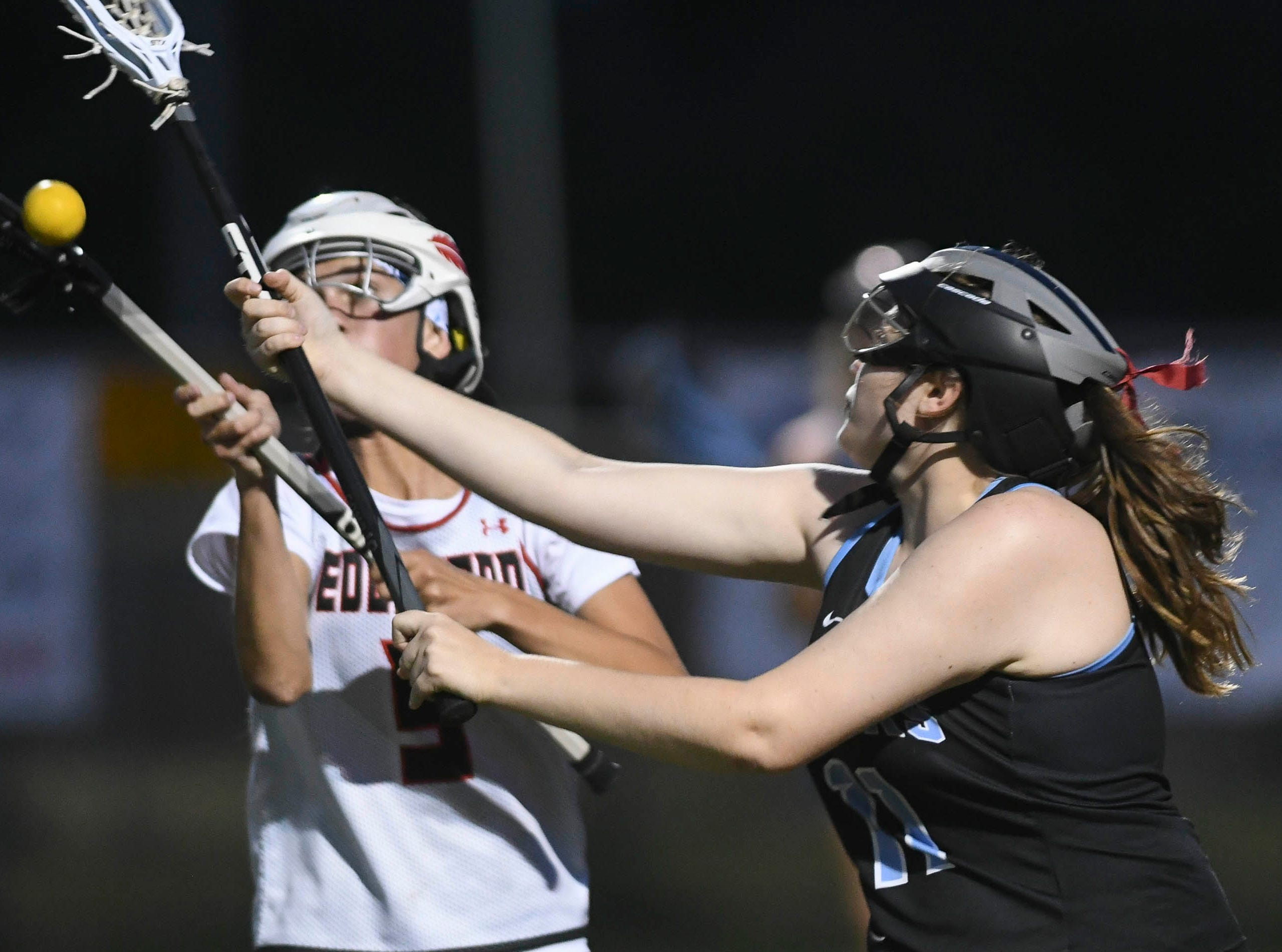 Taylor Koshlap of Edgewood and Lauren Carmichael of Rockledge chase the ball during Tuesday's game.