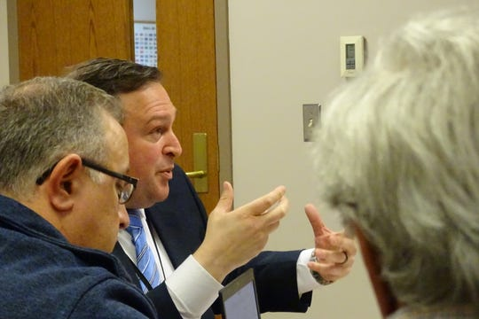 Chad Stover, a U.S. Census partnership specialist, center, speaks at a Crawford County commissioners meeting Wednesday as John Rostash, left, Crestline village administrator; and Tom O'Leary, Galion mayor, listen.