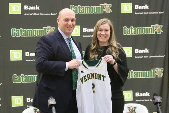 UVM women's basketball coach Alisa Kresge, right, and athletic director Jeff Schulman pose on Tuesday. Kresge was formally introduced as the Catamounts' new coach.