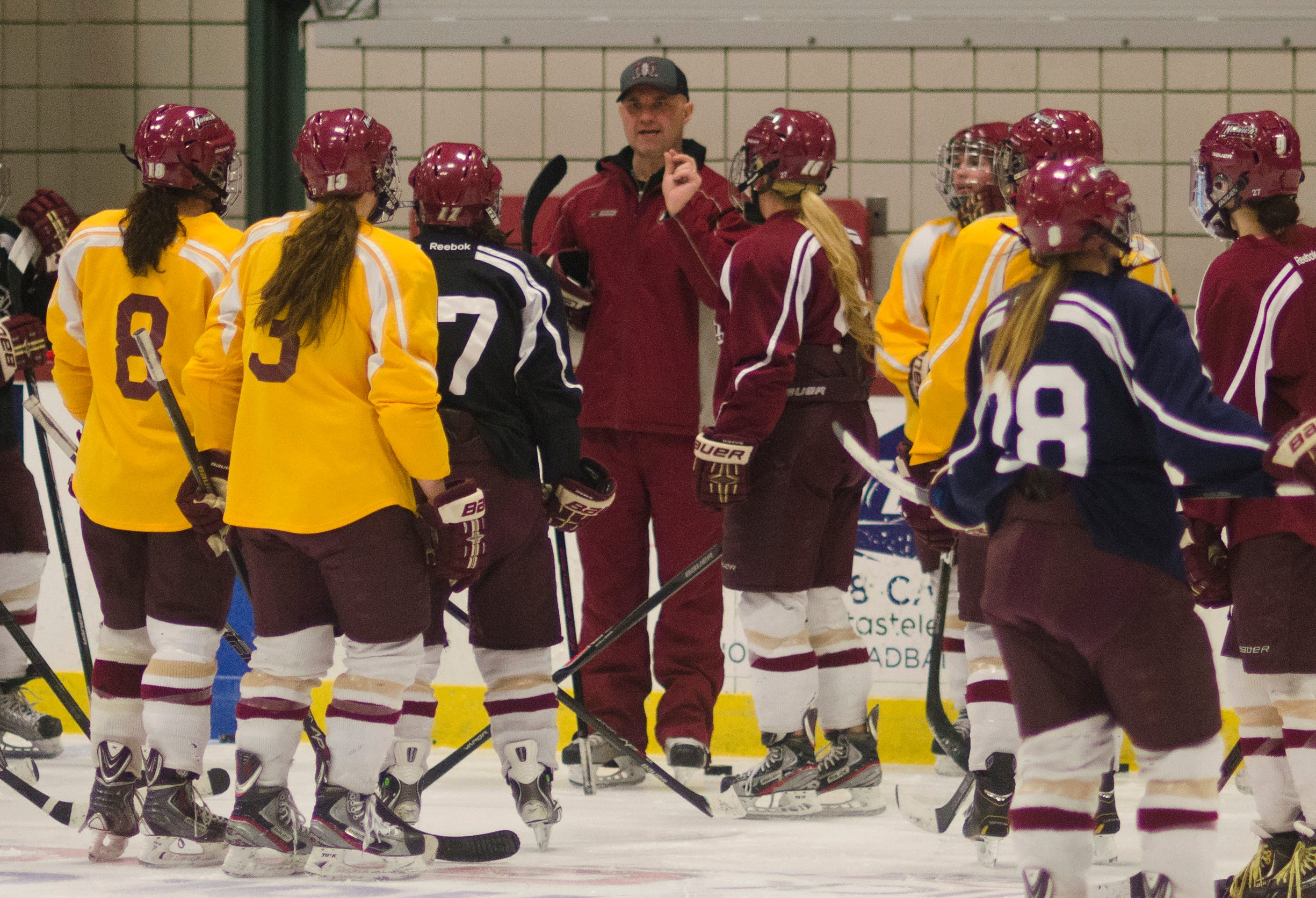 Norwich women's hockey coach Mark Bolding addresses his team during practice  in Northfield ahead of the Cadets' game against  Wisconsin-River Falls in the 2014 Division III national semifinals in Plattsburgh, N.Y.