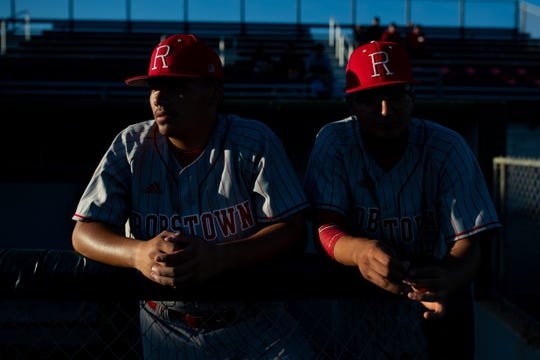Robstown players wait for the start of their game against Sinton at Gene Kaspryzk FIeld, in Sinton on Thursday, April 9, 2019.