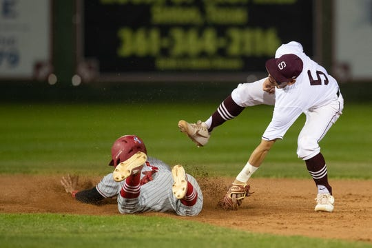 Robstwon's Chris Alonis slides in to second base as Sinton's Chris Garcia tries to tag him out during the sixth inning of their game at Gene Kaspryzk FIeld, in Sinton on Thursday, April 9, 2019.