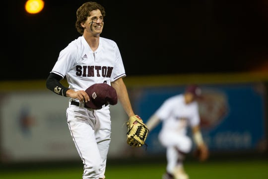 Sinton pitcher Brett Brown smalls after striking out the last batter during the fifth inning of their game against Robstwon  at Gene Kaspryzk FIeld, in Sinton on Thursday, April 9, 2019.