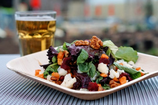 Harvest Salad from Root to Leaf Food Truck is paired with a craft beer at Urban Green at the Philadelphia Zoo.
