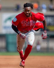 Feb 24, 2019; Lakeland, FL, USA; Philadelphia Phillies center fielder Roman Quinn (24) runs to third base to beat out an infield hit during the first inning against the Detroit Tigers at Publix Field at Joker Marchant Stadium. Mandatory Credit: Reinhold Matay-USA TODAY Sports