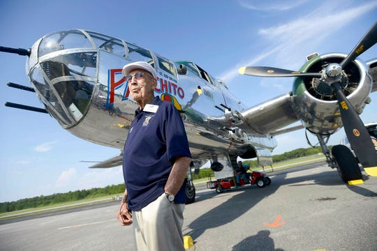 """FILE - In this April 16, 2013 file photo, Doolittle Raider Lt. Col. Dick Cole, stands in front of a B-25 at the Destin Airport in Destin, Fla. before a flight as part of the Doolittle Raider 71st Anniversary Reunion. Retired Lt. Col. Richard """"Dick"""" Cole, the last of the 80 Doolittle Tokyo Raiders who carried out the daring U.S. attack on Japan during World War II, has died at a military hospital in Texas. He was 103. A spokesman says Cole died Tuesday, April 9, 2019, at Brooke Army Medical Center in San Antonio, Texas. (Nick Tomecek/Northwest Florida Daily News via AP, File)"""