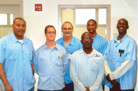 Lindsey Bolar, far right, smiles for the camera as an inmate enrolled in an Offenders Mentor Certification Program in 2009 at California's Solano state prison.