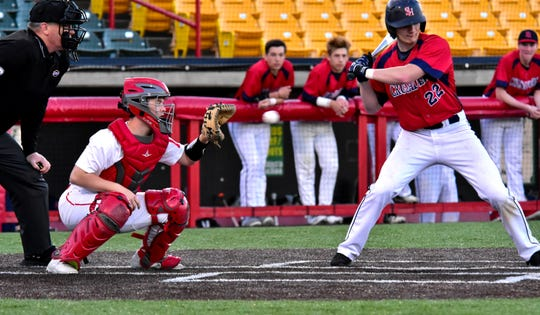 Catcher Clay Trusty looks to snag a called strike three for an out for Beechwood as Jake Brockman of St. Henry watches the pitch sail by at the 9th Region All A Classic Championship played at UC Health Stadium in Florence, KY, April 9, 2019.
