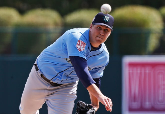 Seattle Mariners starting pitcher Erik Swanson pitches in the second inning of a spring training baseball game against the Los Angeles Dodgers, Saturday, March 9, 2019, in Phoenix.