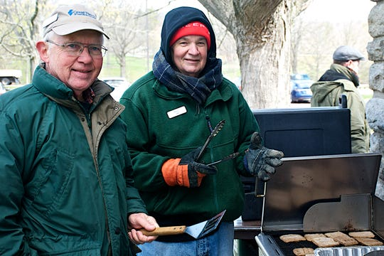 Volunteers Dale Hoffmann (left) and Paul Luckey (right) on the grill crew at a previous Winton Woods Cleanup.