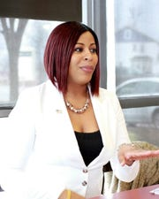 Pam Rocker outlines her platform in an interview at Dunkin Donuts