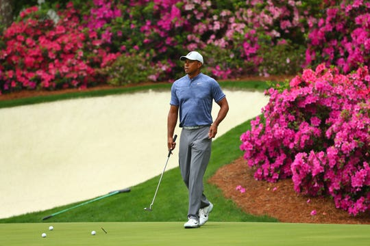 Tiger Woods putts on the 13th green during a practice round for the Masters golf tournament at Augusta National Golf Club.