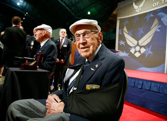 """FILE - In this April 18, 2015, file photo, two members of the Doolittle Tokyo Raiders, retired U.S. Air Force Lt. Col. Richard """"Dick"""" Cole, seated front, and retired Staff Sgt. David Thatcher, seated left, pose for photos after the presentation of a Congressional Gold Medal honoring the Doolittle Tokyo Raiders at the National Museum of the U.S. Air Force at Wright-Patterson Air Force Base in Dayton, Ohio. Retired Lt. Col. Richard """"Dick"""" Cole, the last of the 80 Doolittle Tokyo Raiders who carried out the daring U.S. attack on Japan during World War II, has died at a military hospital in Texas. He was 103. A spokesman says Cole died Tuesday, April 9, 2019, at Brooke Army Medical Center in San Antonio, Texas. (AP Photo/Gary Landers, File)"""