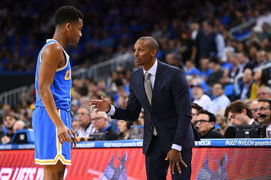 UCLA assistant coach Tyus Edney talks with UCLA guard Jaylen Hands during the game between the USC Trojans and the UCLA Bruins on February 28, 2019, at Pauley Pavilion in Los Angeles, CA.