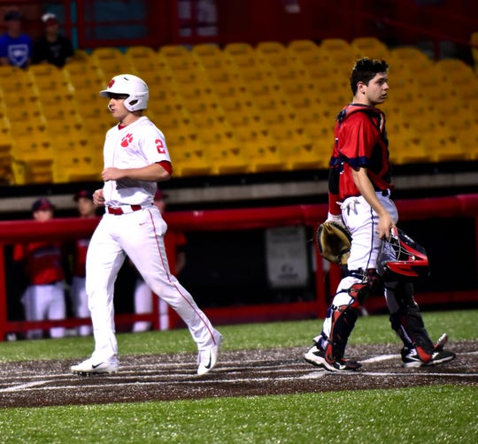 As Beechwood's Logan Castleman (2) plates another run for the Tigers, St. Henry's Catcher AJ Stewart can only walk away from homeplate at the 9th Region All A Classic Championship played at UC Health Stadium in Florence, KY, April 9, 2019.