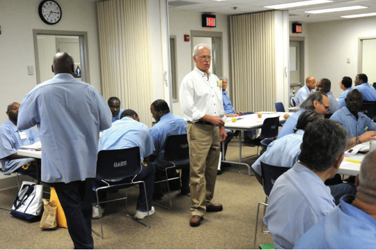 Tom Gorham, center, leads inmates in the Offender Mentor Certification Program at California's Solano prison in 2009. It is a program that Bond Hill Cincinnati resident Lindsey Bolar enrolled in and that changed his life.