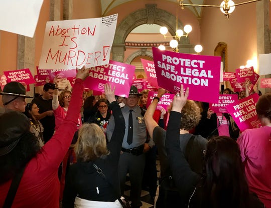 "People rally to support and oppose the ""heartbeat bill"" outside the Ohio House of Representatives chamber at the Ohio Statehouse on April, 10, 2019."