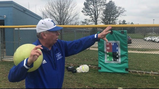 St. Xavier pitching coach Denny Ehrhardt demonstrates a connection drill used by Bombers pitchers.