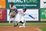 The Iowa Cubs' Zack Short runs past second base during the I-Cubs' home opener against the New Orleans Baby Cakes on Tuesday, April 9, 2019, at Principal Park in Des Moines.