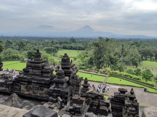 View from the top of one of the oldest Buddhist temples in the world - Borobudur, in Yogyakarta, Indonesia.  Mt. Merapi is the volcano that can be seen in the background.