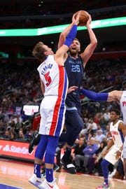 Chandler Parsons #25 of the Memphis Grizzlies takes a first half shot around Luke Kennard #5 of the Detroit Pistons at Little Caesars Arena on April 09, 2019 in Detroit, Michigan.