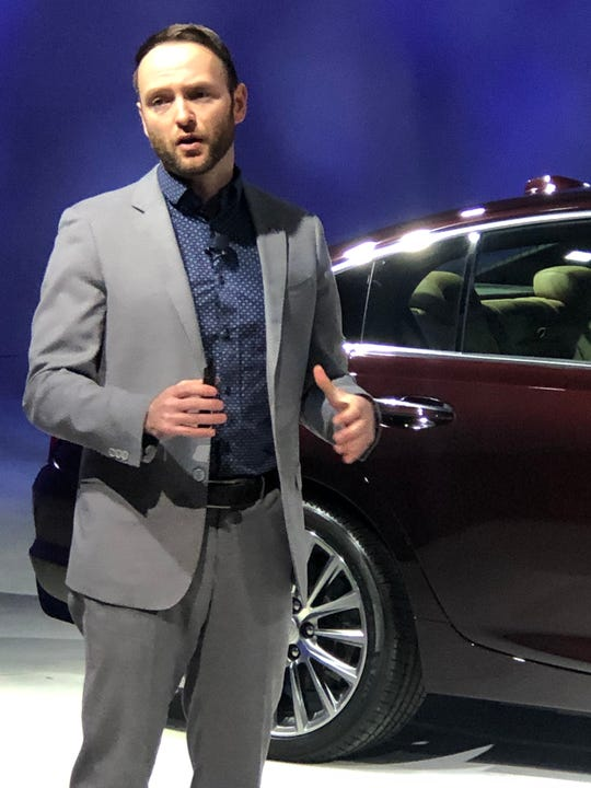 Cadillac Director of Product Marketing Jason Sledziewski stands near the new CT5 luxury sedan.