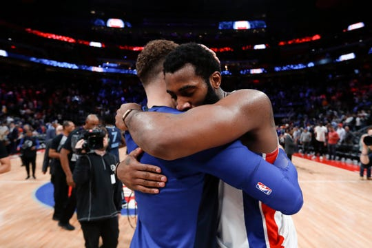 Detroit Pistons forward Blake Griffin, left, hugs Andre Drummond after beating the Memphis Grizzlies 100-93 in Detroit, Tuesday, April 9, 2019.