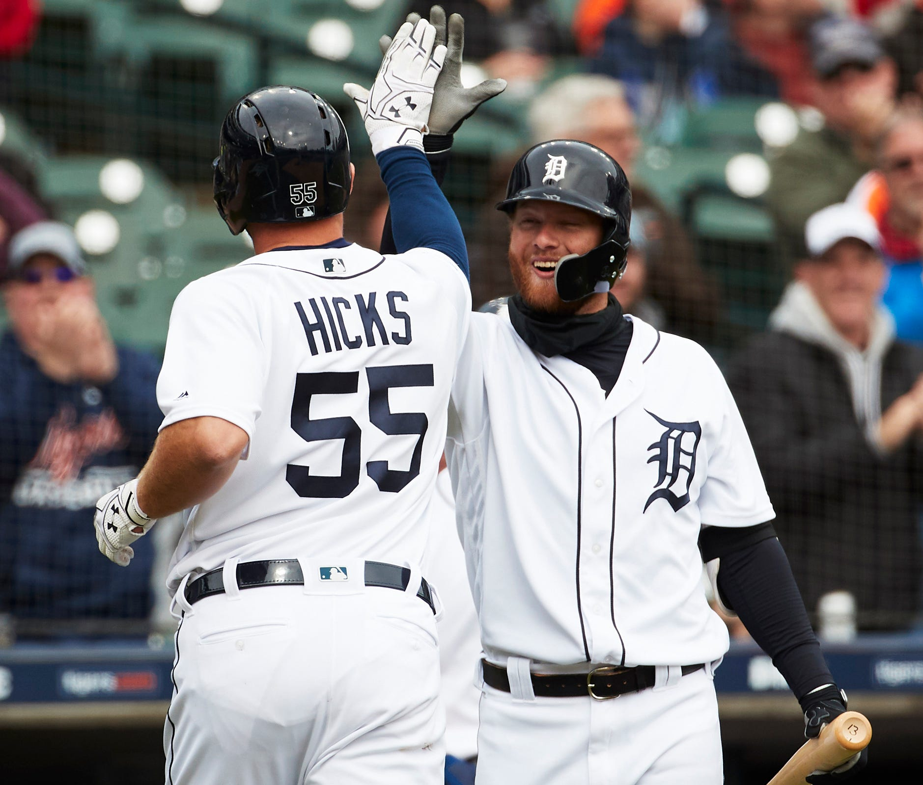 Tigers catcher John Hicks receives congratulations from center fielder Dustin Peterson after he hits a home run in the sixth inning on Wednesday, April 10, 2019, at Comerica Park.