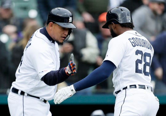 Tigers first baseman Niko Goodrum celebrates with Miguel Cabrera after hitting a two-run home run during the first inning on Wednesday, April 10, 2019, at Comerica Park.