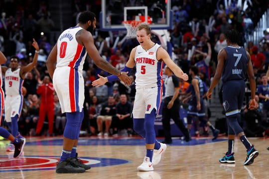 Detroit Pistons guard Luke Kennard (5) celebrates a three-point basket with Andre Drummond (0) in the second half of an NBA basketball game against the Memphis Grizzlies, in Detroit, Tuesday, April 9, 2019.