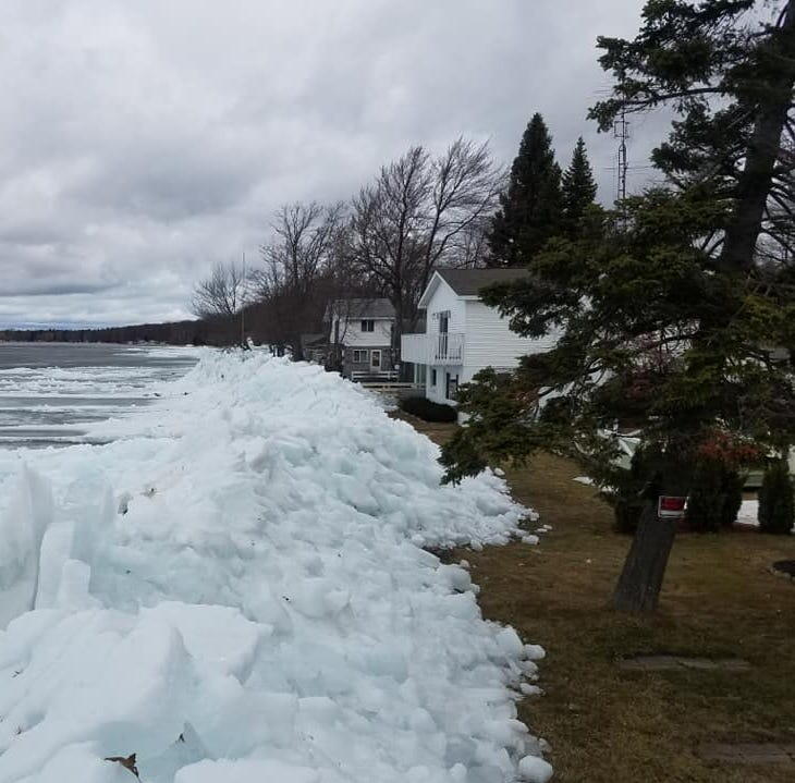 Strong winds smash Houghton Lake ice into Michigan cottages