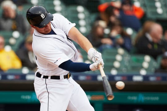 Tigers catcher John Hicks hits a home run in the sixth inning on Wednesday, April 10, 2019, at Comerica Park.
