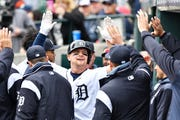The Tigers' John Hicks is congratulated after his solo home run in the sixth inning Wednesday against the Indians.