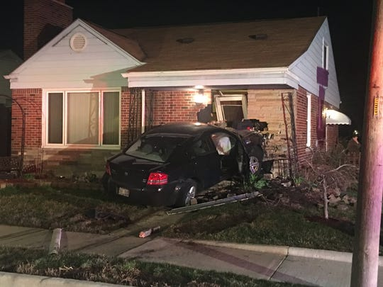 Eastpointe Police said they have arrested a man who crashed a car into a house Wednesday while he was chasing another car.