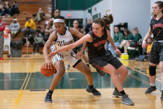 Wayne Memorial guard Jeanae Terry, left, averaged 20.4 points, 9.1 rebounds and 7.8 assists this season.